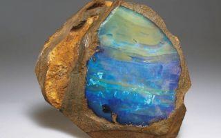 Камень огненный опал — лечебные и магические свойства, уход и фото